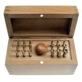 Bezel burnishing set with 18 punches for rubbed-in frame and cabochon sockets